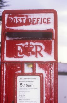 Snow on a postbox in Keswick, Cumbria, UK.